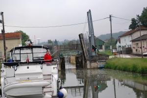 Richard awaits the arrival of barge- note bridge raised and lock ready