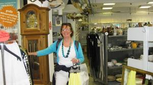 Nuala in charity shop-note grin on her face