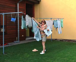Nuala hanging out the washing- note the Waterford Tall Ships bag