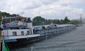 Passing Barge in the pouring rain- Look at it bounce off the water and cargo roof