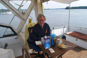 Breakfast on the deck at Boothaus Roll - note swimmers in background