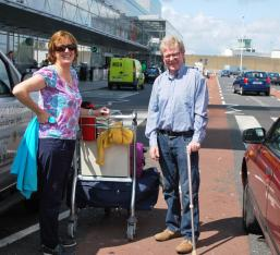 Adrian & Nuala leave for Germany- note Adrian has borrow a walking stick