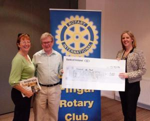 Andrea Molloy President presents cheque for SVP to Adrian and Nuala