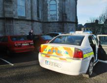 Poice detective examines car