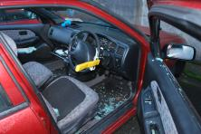 Car with smashed window- glass everywhere