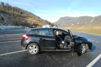 Nuala in the hired car Alps in backround