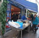 Nuala buys the fish in the market