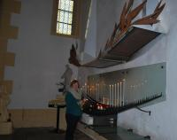 Nuala lights a candle in The Basilica at Paray-le-Monial