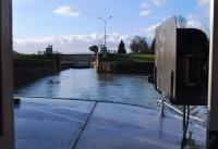 Silhoutte leaving the lock- commercial barge Hercule behind
