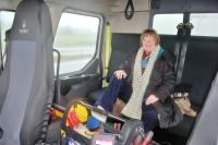 Nuala in the tow truck cab